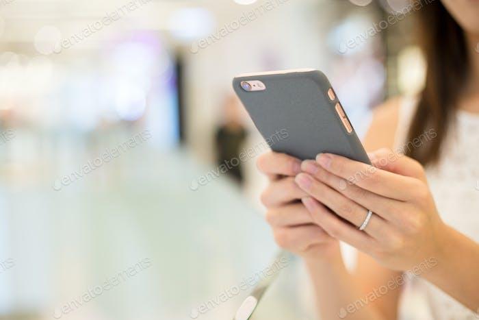 Woman browsing on phone