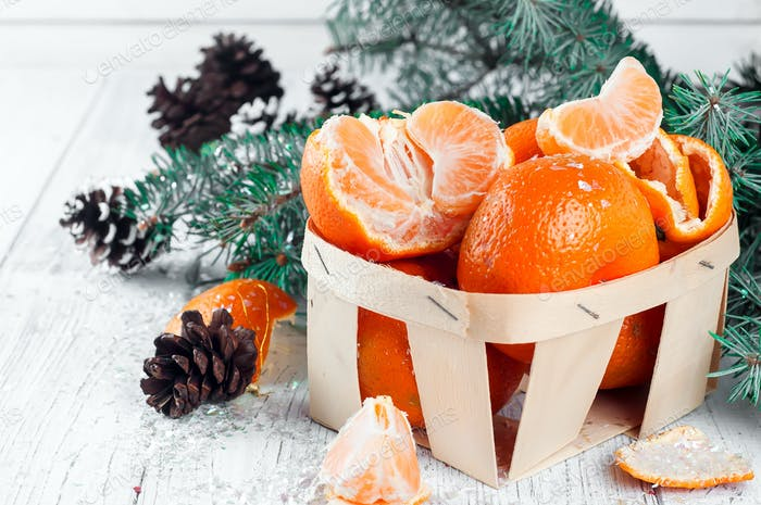 new year composition in basket with mandarins
