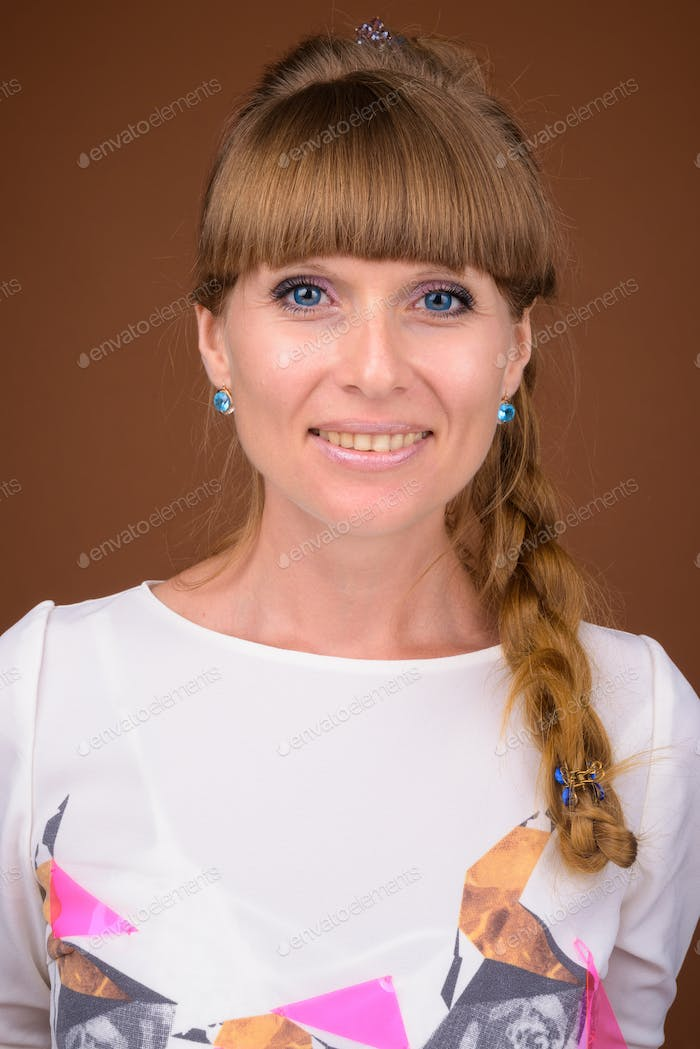 Face of beautiful blonde woman with braided hair