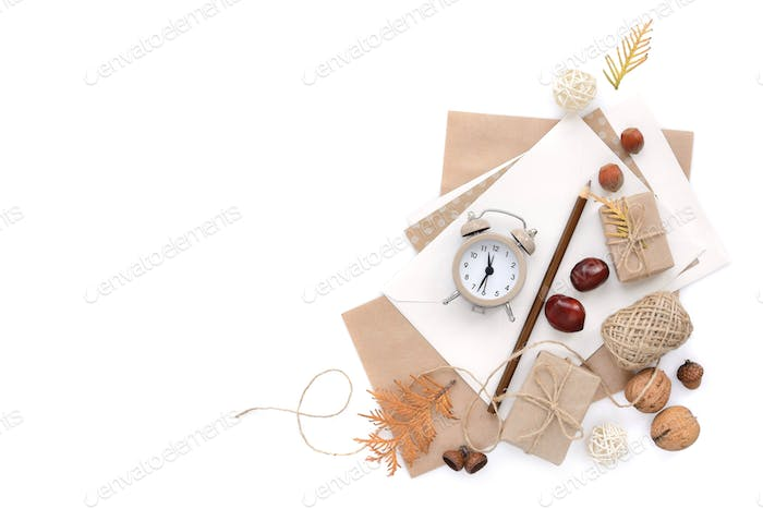 Autumn background with pencils, envelopes and an alarm clock. To