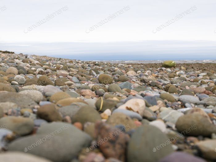 Large rocks on beach close-up perspective