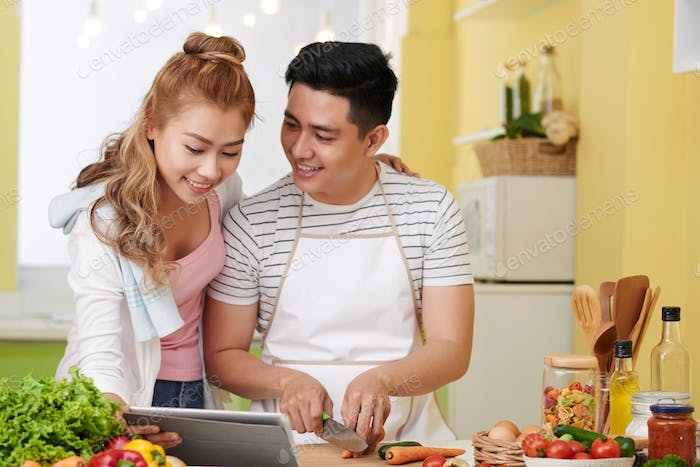 Couple following meal recipe