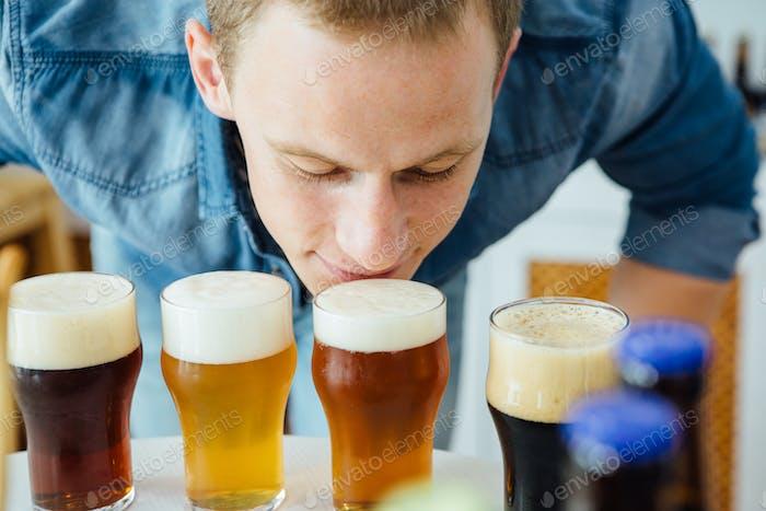 Man smelling craft beer