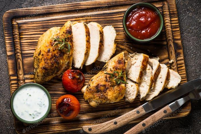 Chicken steak with sauces top view