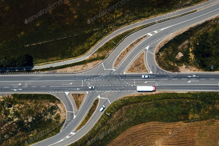 Aerial view of traffic on road intersection with turning lines