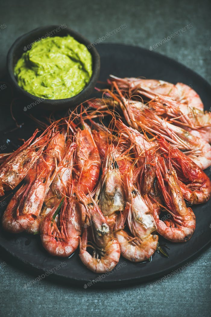 Roasted red shrimps with guacamole avocado sauce in plate