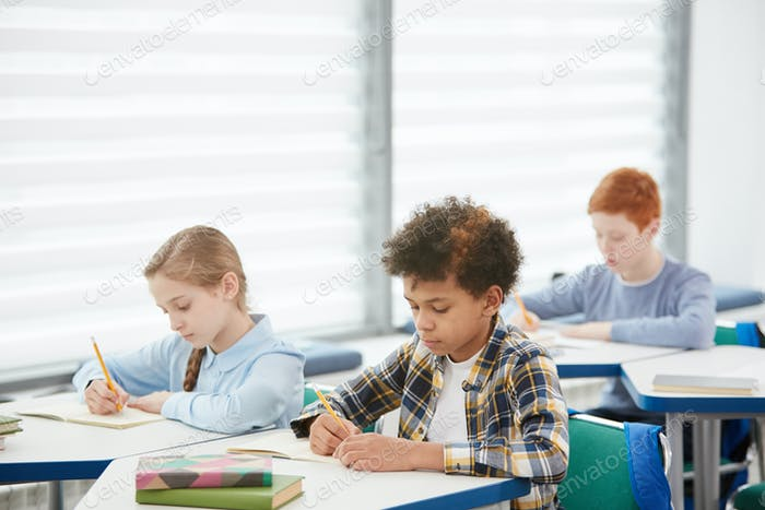 Group of Kids Taking Test in School