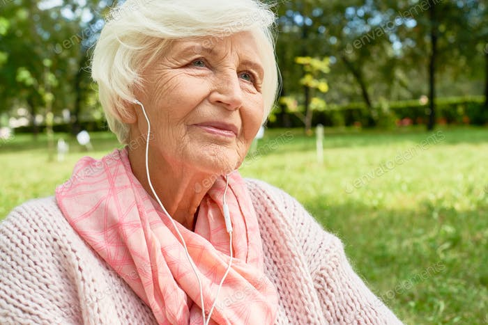 Senior Woman Enjoying Music