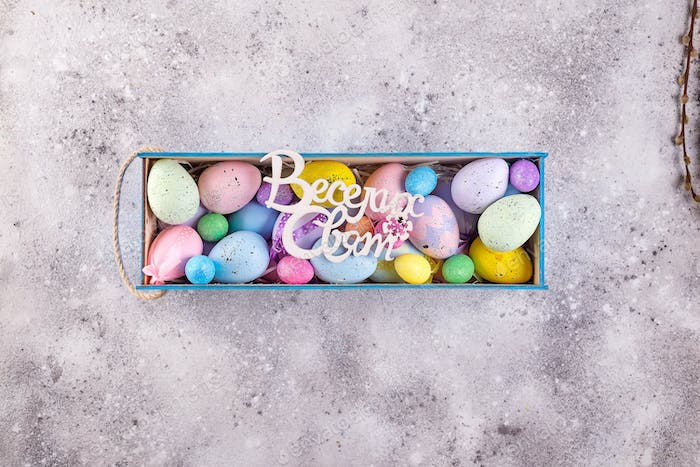 easter colorful eggs painted in bright colors with the text in Ukrainian Happy Holidays in wooden