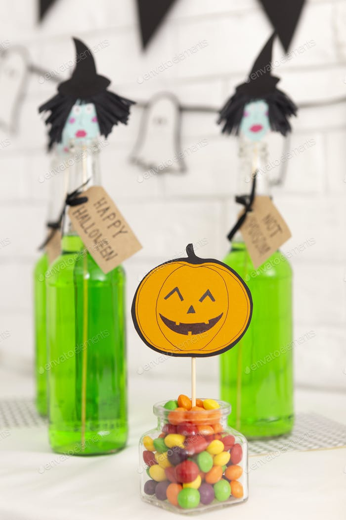 Happy Halloween party with green drinks and candies