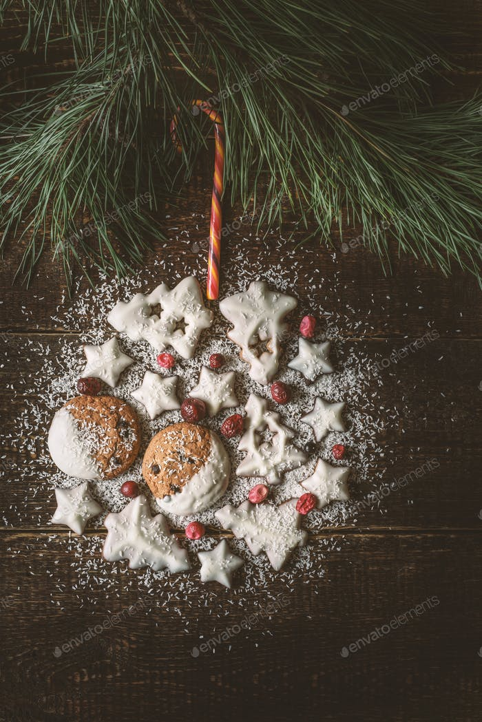 Christmas ball made by  cookies and berries on the wooden background  vertical