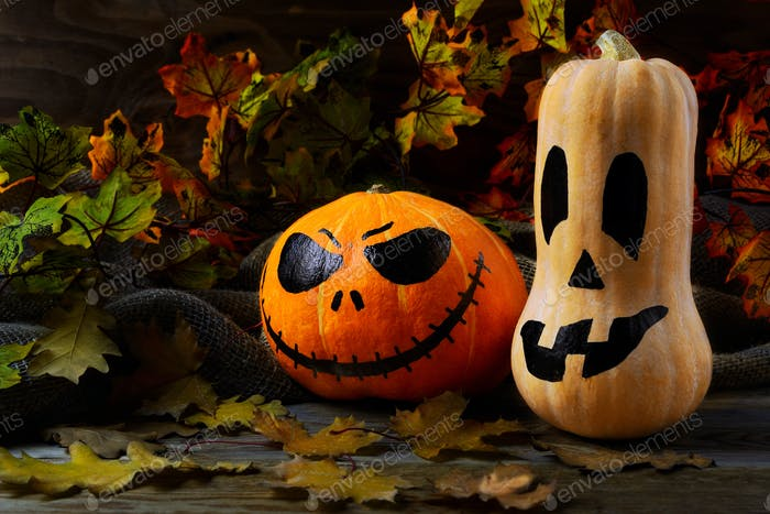 Halloween traditional jack-o-lantern and fall leaves
