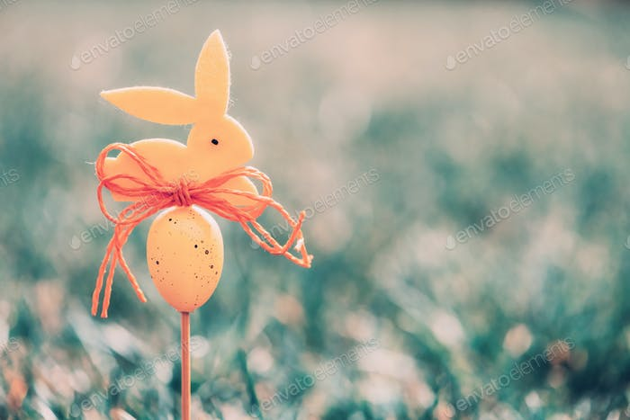 Easter background concept with yellow bunny figure