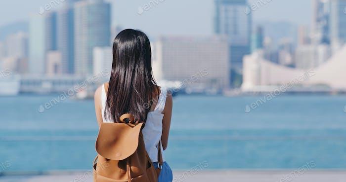 Woman look at the kowloon side in Hong Kong