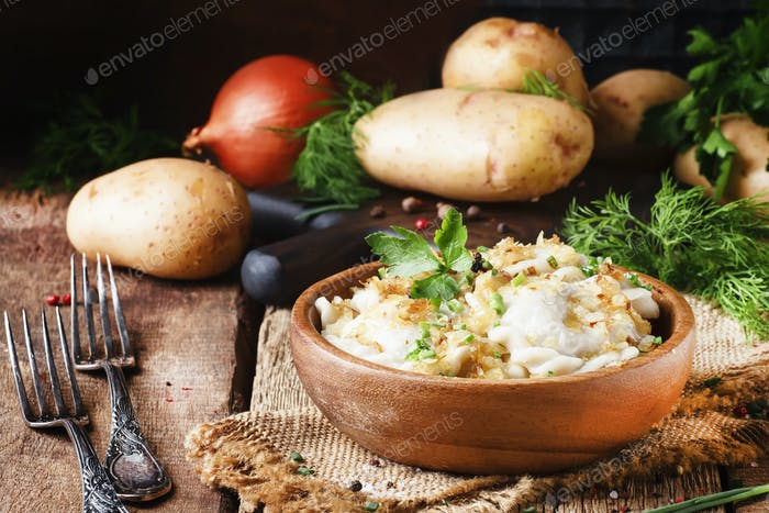 Traditional Russian vareniki with potatoes and fried onions in bowl