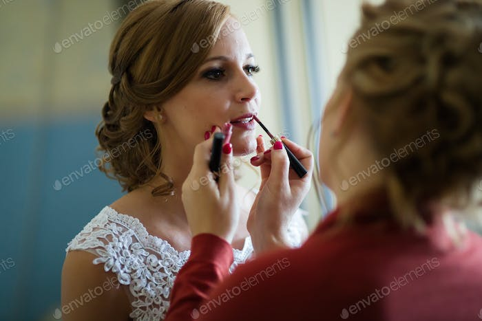 Bride makeup being done by sister