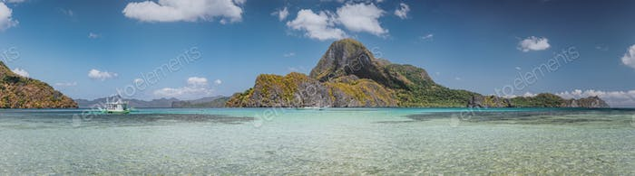 Ultra wide banner of El Nido bay with trip boat and Cadlao island, Palawan, Philippines. Panoramic