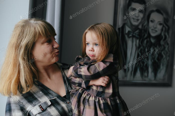Grandmother with her cute granddaughter