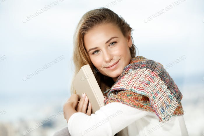 Pretty woman reads a book