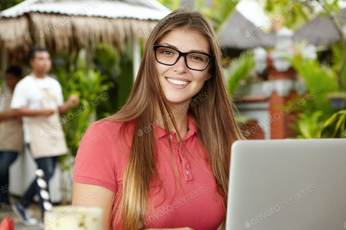 People, lifestyle and modern technology concept. Beautiful smiling businesswoman wearing rectangular
