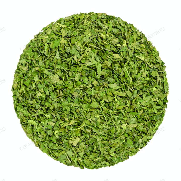 Dried parsley, herb circle from above, over white