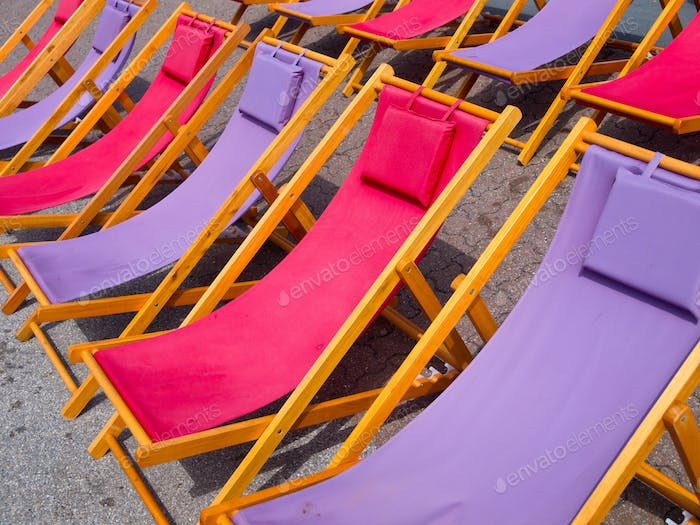 Colorful beach chairs background