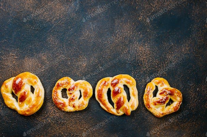baked pretzels on a dark table
