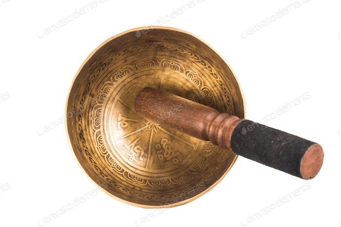 Nepali singing bowl isolated in white