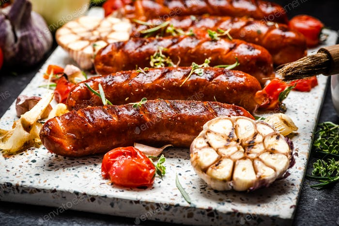 Serving Grilled Barbecue Sausage with BBQ Vegetables and Herbs