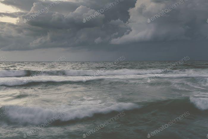 Storm in ocean with big windy waves Northeast Atlantic Coast enhanced sky toned