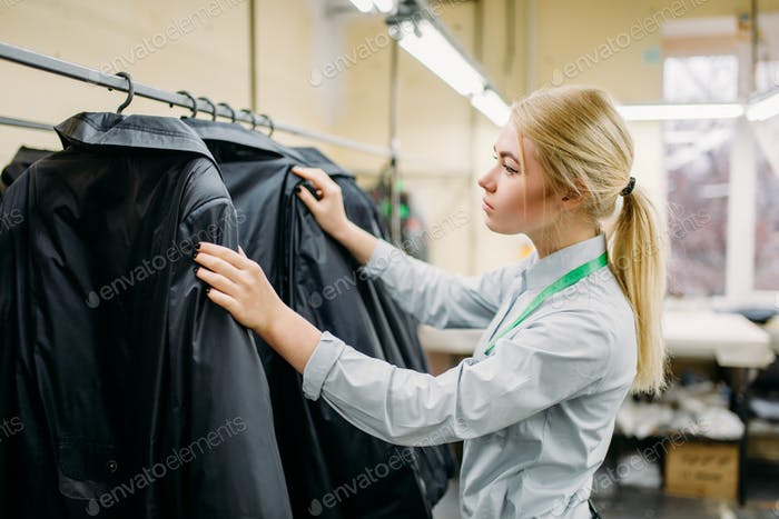 Clothes designer measures length sleeve jacket
