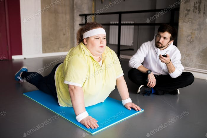 Overweight Young Woman Doing Sports