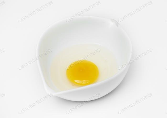 Closeup of fresh organic egg yolk in cup