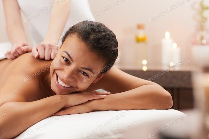 Smiling Woman Enjoying Massage