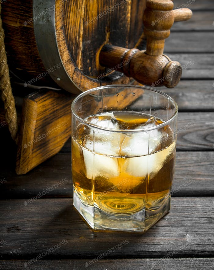 Whiskey in a glass and a barrel.