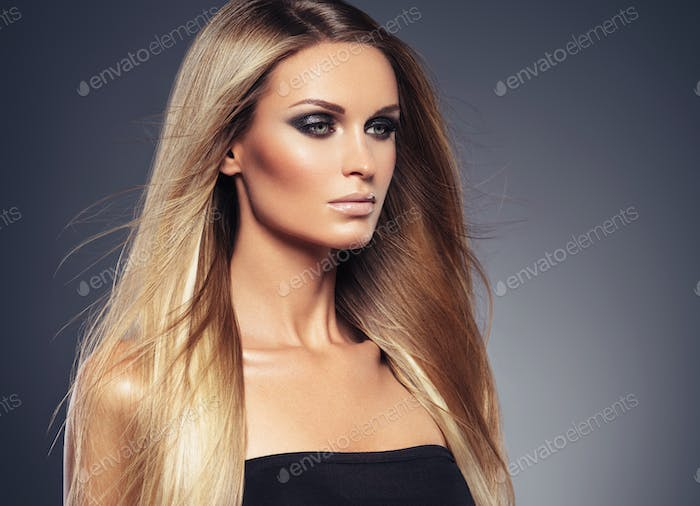 Hair beautiful long blond hairstyle woman fashion makeup healthy skin and hair black background
