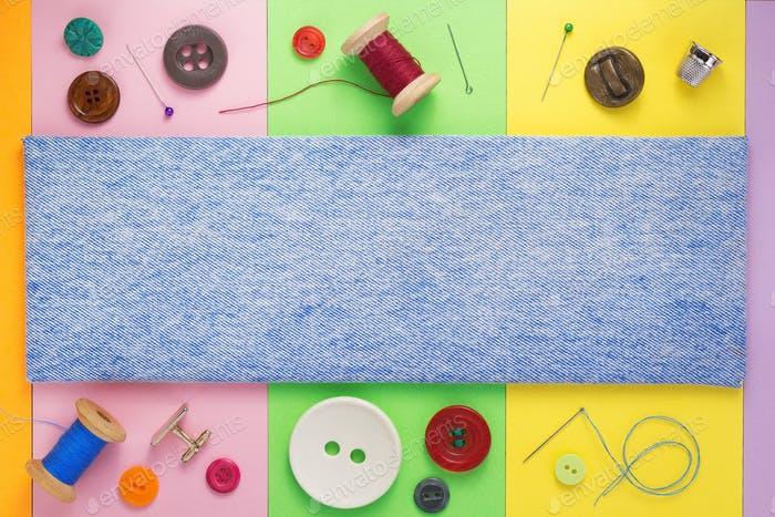 sewing tools and accessories with jeans background texture