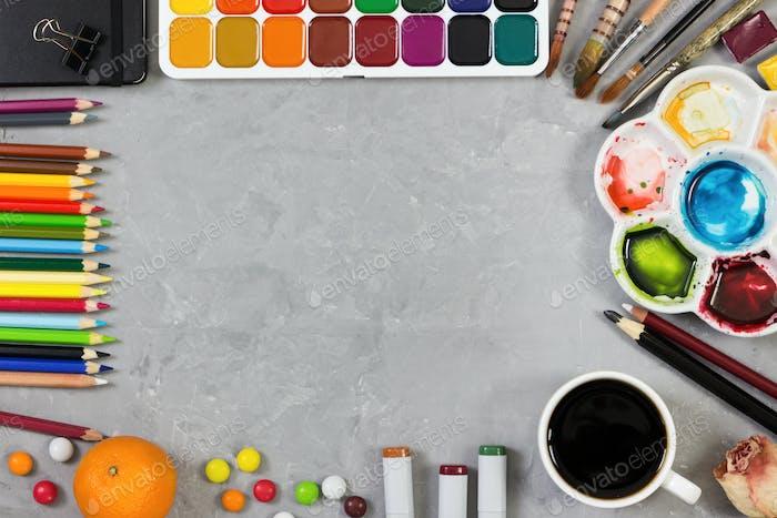 Artist workspace on gray stone background.