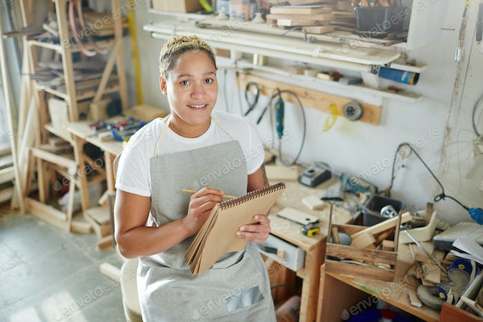 Carpenter with notepad