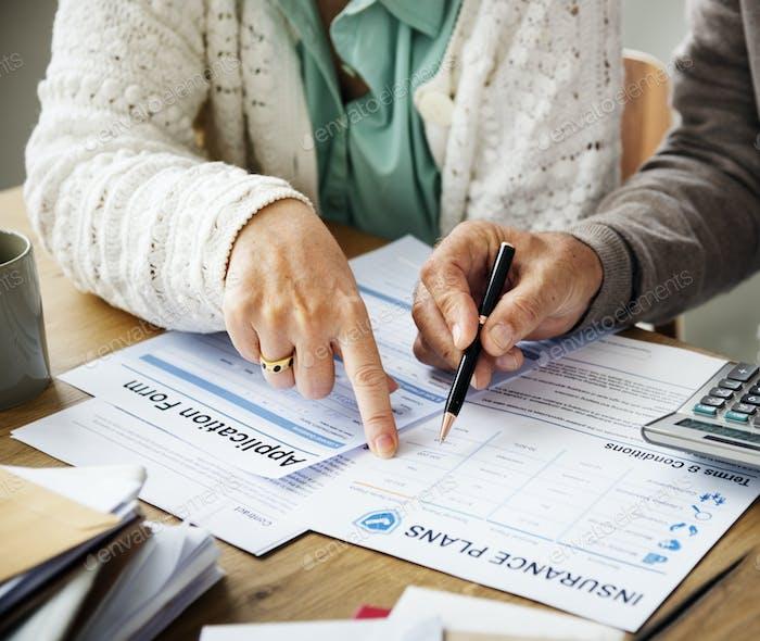 Pensioner filling out aform