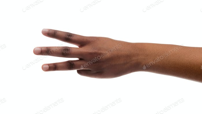 Female hand showing number three with fingers on white background