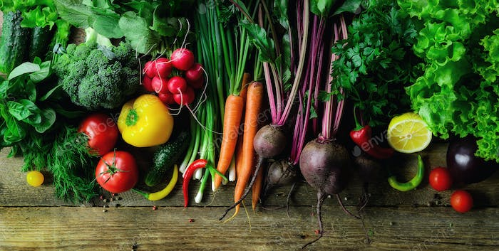 Vegetables on wooden background. Bio healthy organic food, herbs and spices. Raw and vegetarian
