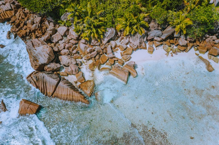 Seychelles. Aerial view of tropical paradise like beach Anse Cocos at La Digue Island with clear