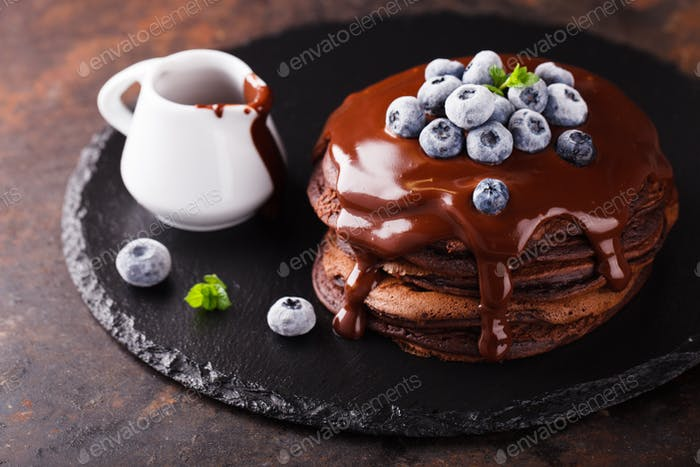 Chocolate pancake with chocolate frosting,blueberries