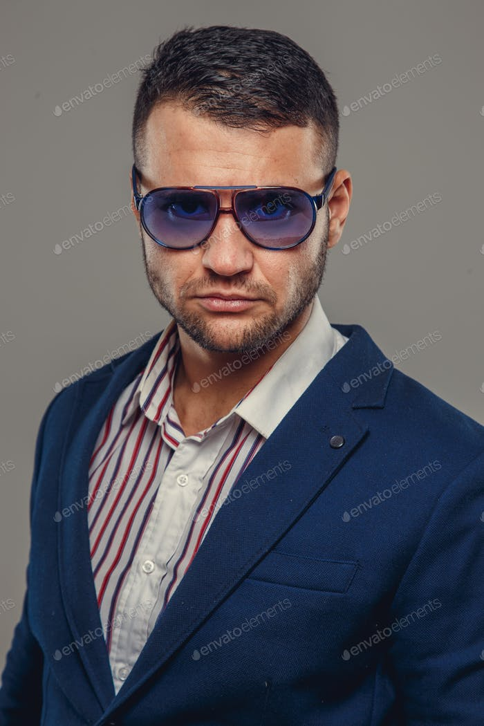 A man in a suit and sunglasses.