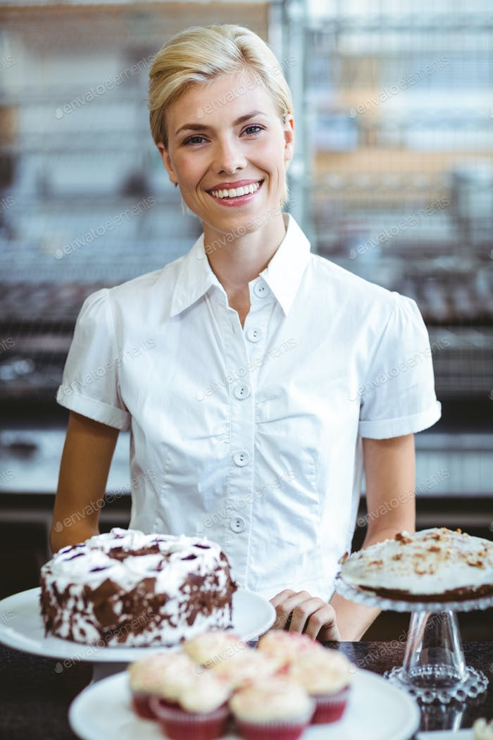 Happy pretty woman preparing plate of cake
