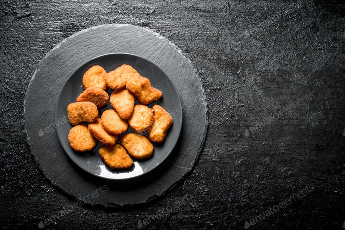 Chicken nuggets on the plate.