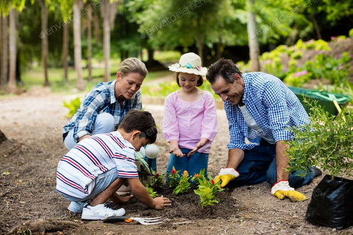 Happy family gardening together