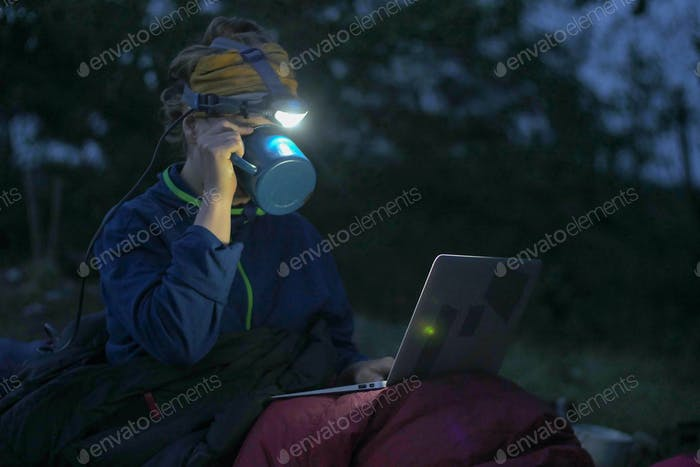 camping laptop at night