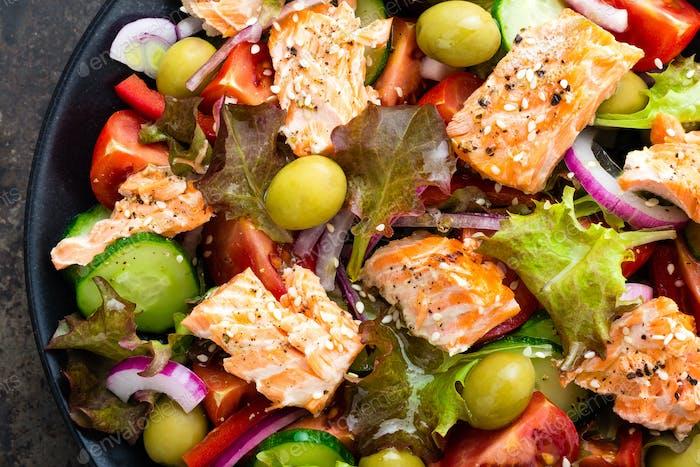 Salad with fish. Fresh vegetable salad with salmon